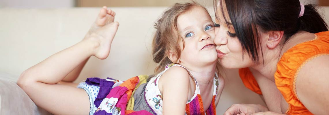 Healthy Child at Home with Mother